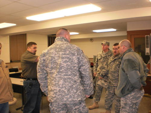 National Guard units being briefed at the Emergency Operations Center
