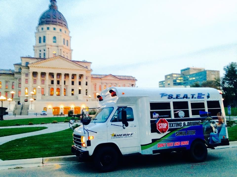 The S.E.A.T. bus outside the capitol building