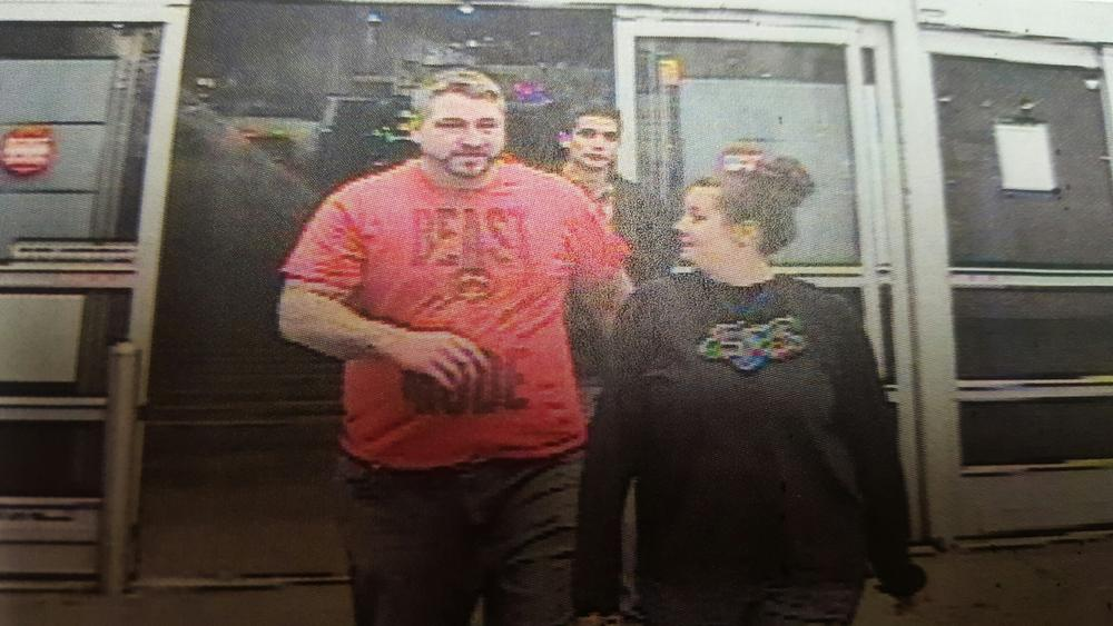 another security camera photo of two individuals - man wearing red Beast Mode shirt and woman in black Fox shirt