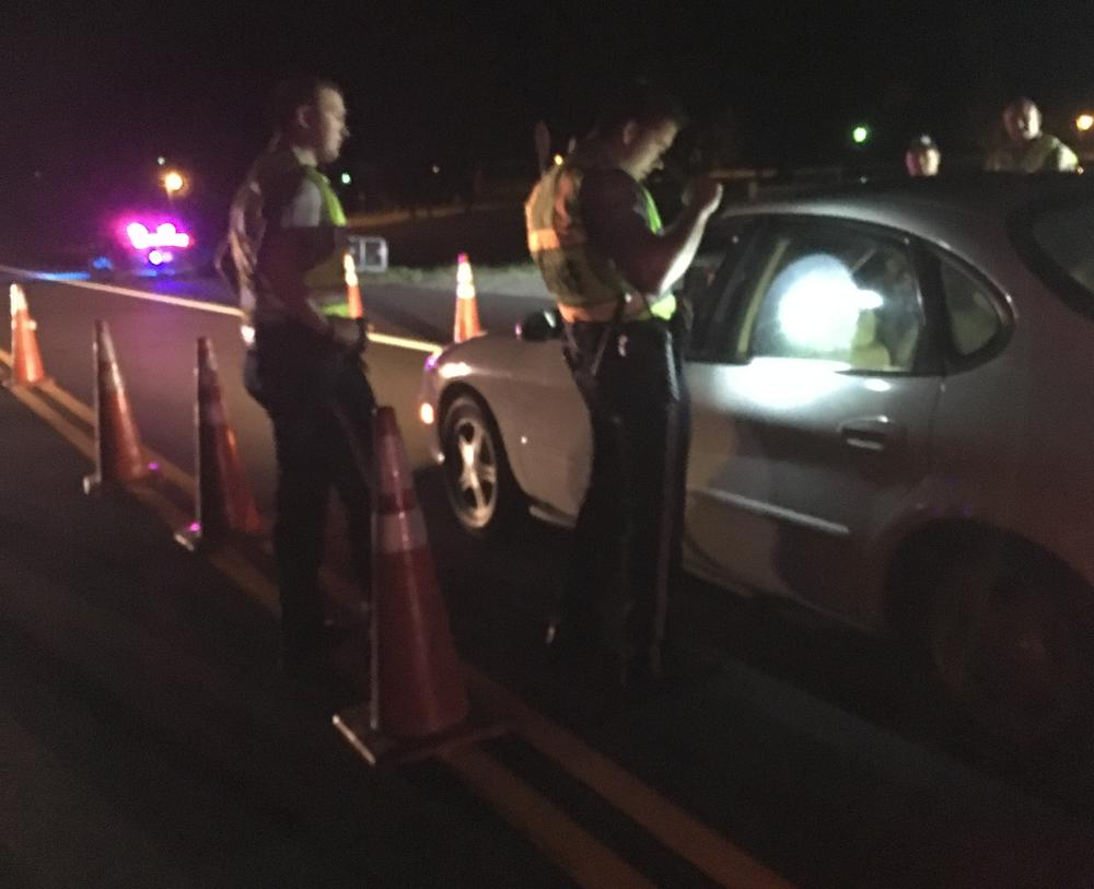 2 officers conducting sobriety checkpoint