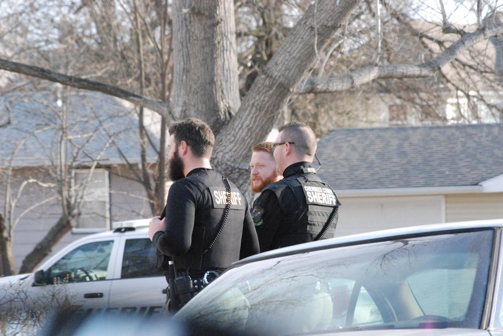 3 officers in uniform standing and talking